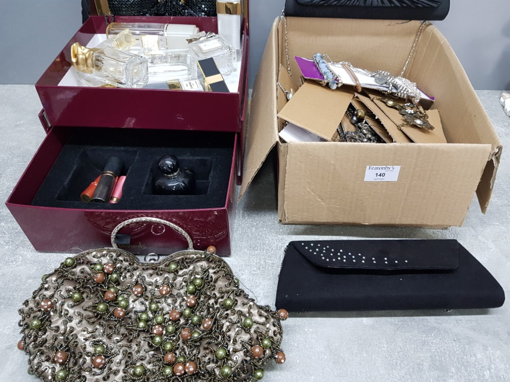 Costume jewellery necklaces and bracelets, four evening bags and empty perfume bottles by dior and