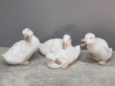 Three Nao white duck figurines and group.