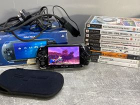 Sony PSP with 10 games, comes complete with charger, protector and original box, in full working