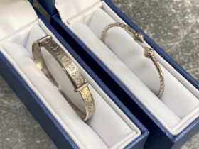 Silver Torq bangle and Silver bracelet, both boxed, 12.5G
