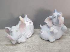 Two Nao elephants, one with bird and the other with butterfly.
