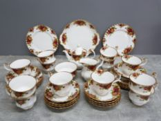 Royal Albert Old Country Roses tea service for 12, one tea plate missing.