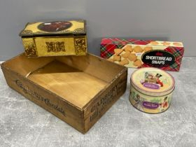 Various vintage tins including Quality street and Cadbury's milk chocolate wooden crate