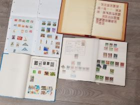 4 albums of miscellaneous stamps from around the world