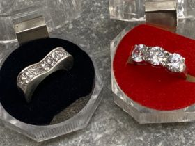 2 silver and CZ rings, sizes L and M (3 stone), 10.5G gross