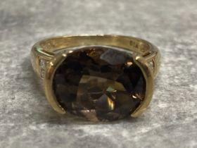 9ct gold Smokey quartz ring with diamond shoulders, 3.79g