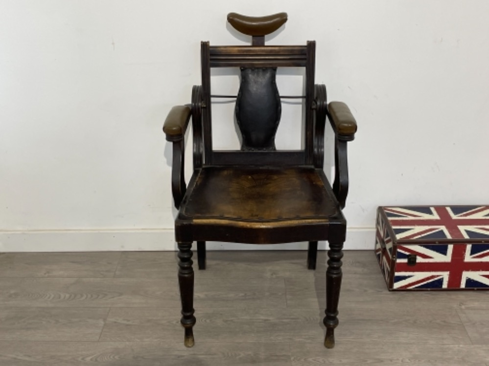 Early 20th century Barbers chair with adjustable back.