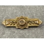 9ct gold diamond bar brooch. Set with old cut diamond in centre