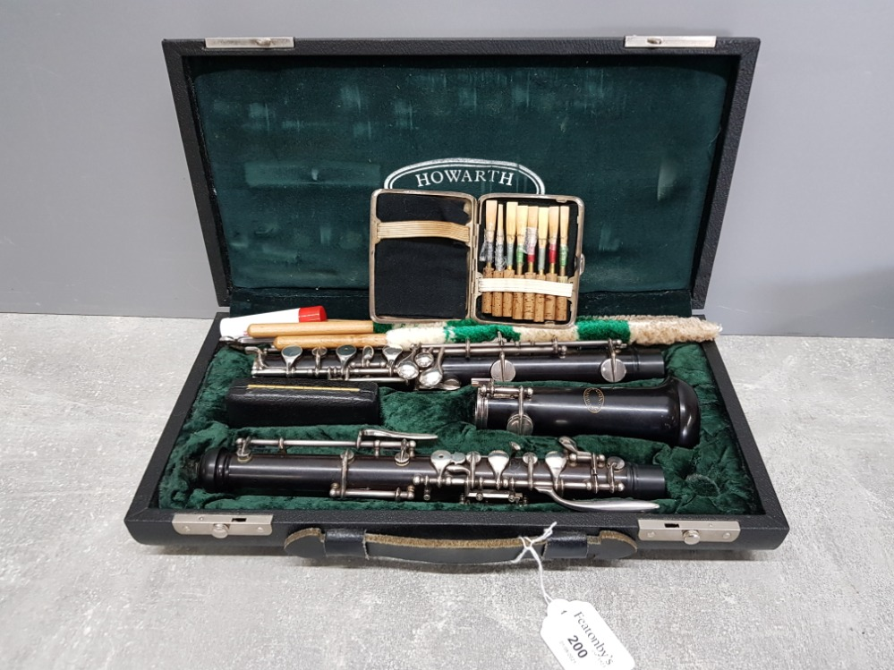 A Howarth of London oboe in ebony and silver plated metal mounts, no C0624, in fitted case.