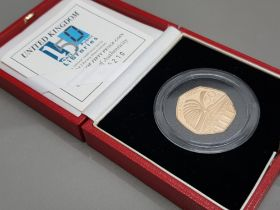 UK gold 2000 public library milestones 22ct 50p gold coin, 15.50 grams, in original case with