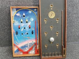 Vintage space rocket themed pinball board together with wooden Bagatelle board