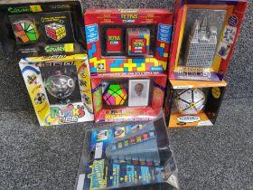 7 boxed vintage puzzles including Rubiks 360, Tetris cube, Metropolis etc