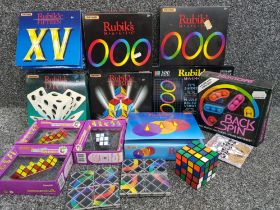 Box of Rubiks puzzles including M.a.g.i.c, Dice, clock puzzle etc most boxed