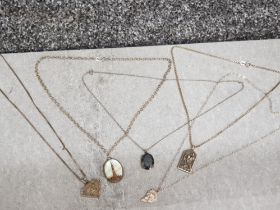 5 pendants on 5 silver chains, including mother of pearl, 2 pendants marked silver, 27.2G gross