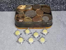 Tins of mixed coinage and 7 Dental nurses society badges