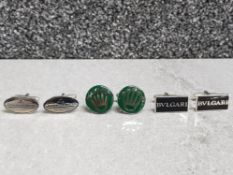 Three cufflinks in the style of Jaeger Le Coultre, Rolex and Bvlgari.