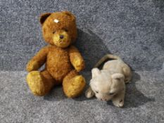 A Steiff tiger cub and a teddy with articulated arms and legs.