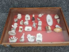 Vintage wooden display case with lift up lid, including contents, hornsea fauna, crested ware etc