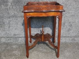 A mahogany Chippendale style silver or centre table with pierced gallery and stretchers 50 x 72cm.