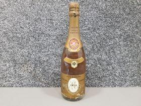 A vintage bottle of 1979 Louis Roederer Cristal champagne, 75cl.