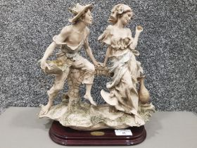 Giuseppe Armani Florance group depicting a courting couple, stamped and signed 32cm high.