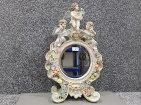 A late 19th century Sitzendorf porcelain toilet mirror decorated with cherubs and flowers 59 x