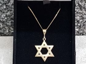 A 9ct gold Star of David pendant and 9ct gold chain 3g.