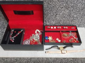 Costume jewellery to include rings, earrings, cocktail watches, in a black jewellery box.