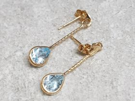 Pair of 9ct yellow gold blue topaz earrings, 0.79g