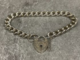 Ladies Silver charm bracelet with patterned padlock and safety chain