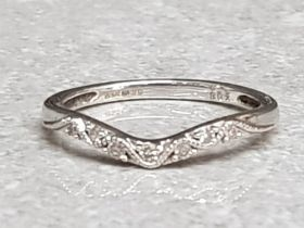 A 9ct white gold and seven diamond set band ring size K1/2 1.4g gross.