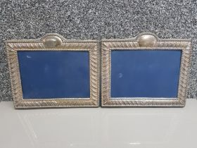 Pair of silver hallmarked rectangular picture frames, 24x21cm