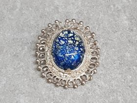Silver and blue stone oval brooch 15.8g gross.