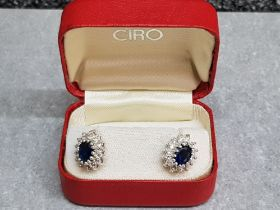 A pair of blue and white paste stud earrings in Ciro box