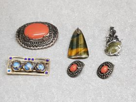 Five items of Scottish style costume jewellery comprising three brooches, pendant, and a pair of
