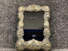 Hallmarked Silver cherub picture frame (22.5cms x 32.5cms)