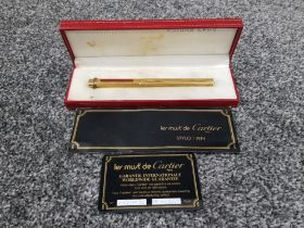 Cartier pen le must de Cartier ballpoint pen with red strips on the front in original box with