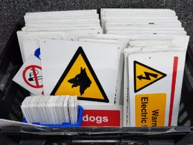 Box containing a variety of different notice & danger signs, well over 100