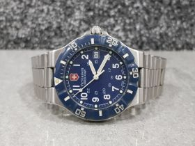 Gents stainless steel victorinox swiss army watch with blue dial and bezel date display at 3