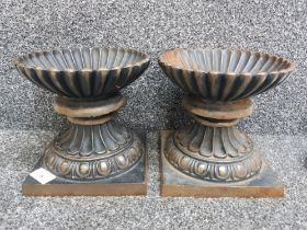 Pair of heavy cast iron urns, height 18.5cm