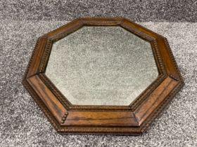 Oak octagonal bevelled edge mirror (49cms)