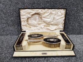 Silver and tortoise shell 4 brush set in original case with ornate design on the brushes a+j Smith