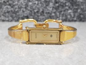 Ladies gold plated Gucci watch with rectangular face quartz movement