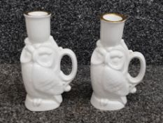 A pair of Royal Doulton ceramic chambersticks in the form of owls 13cm high (seconds).