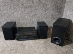 A Hitachi stereo tuner amplifier HTA-MD20, a pair of Denon speakers SC-M39, and a Bush subwoofer b-