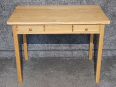 A solid oak side table with two single drawers 100 x 75 x 60cm