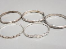 5 x ladies silver bangles, 3x hollow patterned bangles with safety chains, 1x ornate celtic design