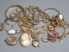 A bag of gold plated jewellery, including bangles, chains, lockets, brooches & rings