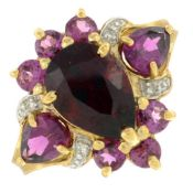 A red and purple garnet and diamond ring.Stamped 375.Ring size N.