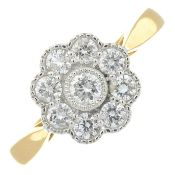An 18ct gold diamond floral cluster ring.Total diamond weight 0.54ct.Hallmarks for 18ct gold.